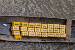 NAPO, PERU - JULY 15, 2015: beer cans in a canoe on a river Napo, Pe. Ru royalty free stock photos
