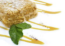 Napoleaon cake with mint leaves and syrup Royalty Free Stock Image