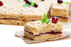 Napoleon   cake with cranberry and mint on white background Royalty Free Stock Photos