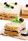 Napoleon  cake  with cranberry and mint on white background Stock Images