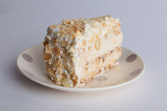 Napoleon cake with nuts on a plate Royalty Free Stock Images