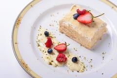 Napoleon cake with strawberries, raspberries, blueberries. Napoleon cake with strawberries, raspberries blueberries, white background Stock Photography