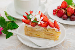 Napoleon cake with strawberries. Wooden background. Close-up. Top view royalty free stock image