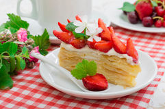 Napoleon cake with strawberries. Wooden background. Close-up. Top view Stock Image