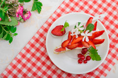 Napoleon cake with strawberries. Wooden background. Close-up. Top view Stock Photos