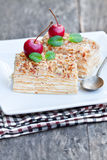 Napoleon  cake with wild apple and mint on squared plate Royalty Free Stock Photography