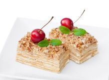 Napoleon  cake with wild apples and mint on squared plate Royalty Free Stock Photos