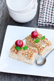 Napoleon  cake with wild apples and mint on squared plate Royalty Free Stock Photography