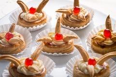 Napoleon cakes. With cherries and cream stock photo