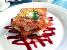 Napoleon dessert. On the plate with jam stock photo