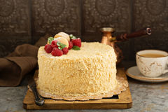 Napoleon layered cake with macarons and raspberry. Napoleon layered cake with macarons and fresh raspberry Stock Photography