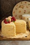 Napoleon layered cake with macarons and raspberry. Napoleon layered cake with macarons and fresh raspberry Royalty Free Stock Photos