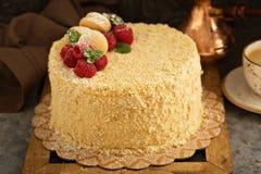 Napoleon layered cake with macarons and raspberry. Napoleon layered cake with macarons and fresh raspberry Royalty Free Stock Image