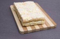 Napoleon pastry. Home made napoleon pastry on a board Royalty Free Stock Photography
