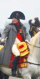 Napoleon som rider en häst på historisk reenactment Royaltyfria Bilder