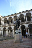 Napoleon Statue and some people around. Milan, Italy - February 08, 2015: Accademia di Brera courtyard in Milan, with Napoleon Statue and some people around Stock Photos
