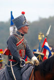 Napoleonic war soldier - reenactor rides a horse Royalty Free Stock Photography