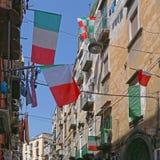 Napoli Naples. Italian and Napoli Flags at Narrow Street in Residential District of Naples stock photos