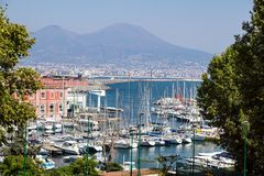 Napoli Naples and mount Vesuvius in the background at sunset in a summer day, Italy, Campania.  stock photos