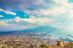 Napoli or Naples and mount Vesuvius in the background at sunset in a summer day. Italy, Campania royalty free stock photos