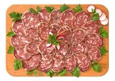 Napoli salami. On wooden board stock image