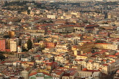 Napoli at sunset. Typical Italian landscape with bright, warm colored houses. A lot of clustered areas Stock Photo