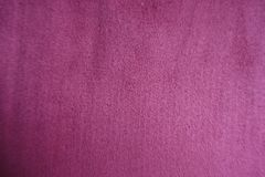 Napped velvety fabric from above red. Napped velvety fabric surface from above red Stock Images