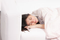 Napping brunette Royalty Free Stock Photos