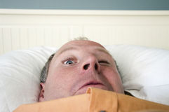 Napping businessman with one eye opened Royalty Free Stock Images