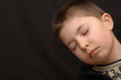Napping child. Napping child, aged 9, takes a moment to catch up on some sleep. Horizontal orientation. Copy space stock image