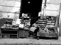 Napping witchcraft seller in La Paz Bolivia. Black and white portrait of a sleeping elderly witchcraft stall holder in market in La Paz Bolivia Royalty Free Stock Photography