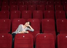 Napping woman at the cinema Royalty Free Stock Photography