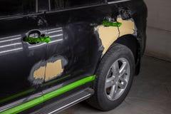 Naprawa samochodowe części ciałe w czerni po podrapania i wypadku zdjęcia royalty free
