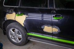 Naprawa samochodowe części ciałe w czerni po podrapania i wypadku fotografia royalty free