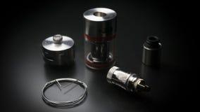Naprawa, utrzymania vaper przyrządu mod Części nowożytny odparowalnika cig przyrząd, dodatkowe części Mikro zwitki clearomizer No Zdjęcie Stock