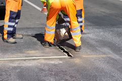 naprawiania ulicy pracy Obrazy Royalty Free