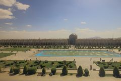 Naqsh-e Jahan Square or Iman Square with its garden, fountain pool and row of arcade shops with Sheikh Lotfollah Mosque. stock photo