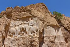 Naqsh-e Rustam, Iran. Rock relief of the investiture of Ardashir I royalty free stock photos