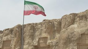 Naqsh-e Rustam necropolis and flag stock video