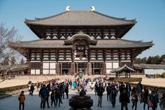 NARA, JAPAN - JAN 30, 2018: Tourists and locals walking in Daibutsu Den in Todaiji temple of Nara royalty free stock images