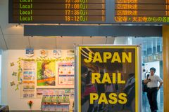 Nara, Japan - July 26, 2017: Informative sign with the departure time of trains inside of the railway station at Royalty Free Stock Image