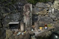 Nara, Japan - May 31, 2017: Old stone sculpture honoured with c stock photo