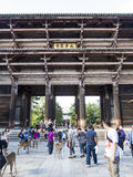 Nara Todai-ji gate with visitors and deer Stock Images