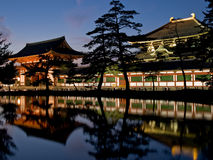 Nara Todaiji temple. Illuminated evening view of the inner gate and wall surrounding Todai-ji temple (called Todai-ji Chuu-mon) with a pond in the foreground in royalty free stock image