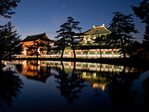 Nara Todaiji temple. Illuminated evening view of the inner gate and wall surrounding Todai-ji temple with a pond in the foreground in Nara, Japan. Todai-ji royalty free stock image