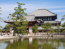 Nara Todaiji temple. View of the inner gate and wall surrounding Todaiji temple with a pond in the foreground in Nara, Japan. Todaiji temple can be seen in the royalty free stock photography