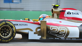 Narain Karthikeyan racing in F1 Singapore GP Royalty Free Stock Photography