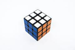 Naranja blanca azul del éxito del cubo de Rubik Fotografía de archivo