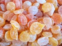 Naranja colorida del caramelo Imagenes de archivo