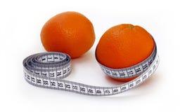 Naranja con la cinta métrica Fotos de archivo libres de regalías